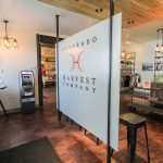 """A store with the sign """"Colorado Harvest Company"""""""