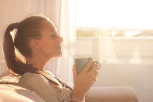 Woman enjoying a cup of coffee on a sunny day
